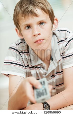 Attractive Young Boy Using A Remote Control