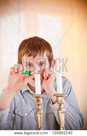 Lone Boy Lighting Candles