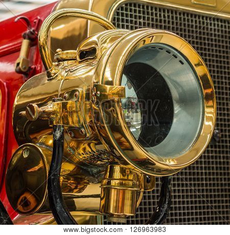 One brass vintage head lamp found on a 1909 Clement Talbot car