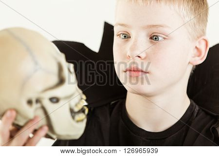 Boy Dressed As Wizard Holding Skull