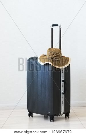 Large Luggage And Wicker Hat On Wooden Background. .