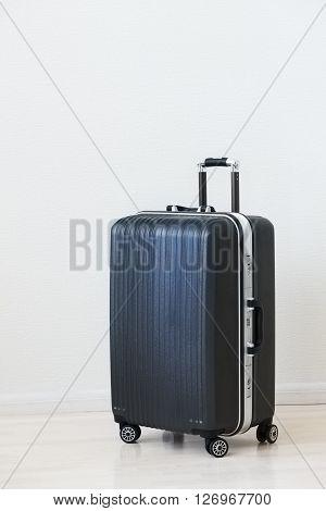 Large Luggage On White Wooden Background.