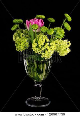 Beautiful Bouquet Of Flowers In Glass Vase On Black Background.