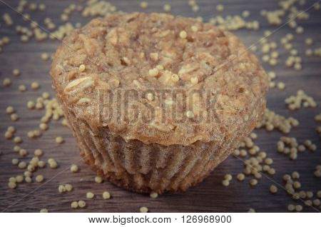 Vintage photo Fresh muffin with millet groats oatmeal flakes cinnamon and apple baked with wholemeal flour concept of delicious healthy dessert or snack