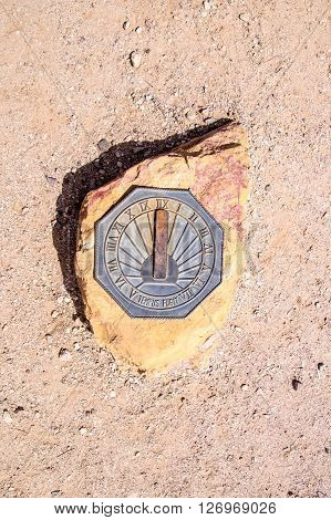 Sun dial on rock in the Arizona desert