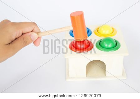Playing colorful hammer case wooden toy stock photo