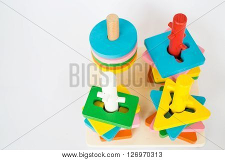 Colorful puzzle wooden toy on white table stock photo