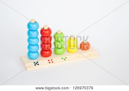 Colorful backgammon wooden toy on white table stock photo