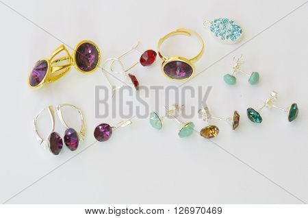 Female accessories: gem stone pendants rings and earings