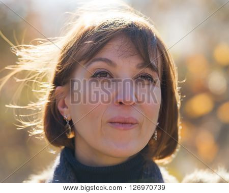 portrait of a woman on a sunny day in the park age of 40 years