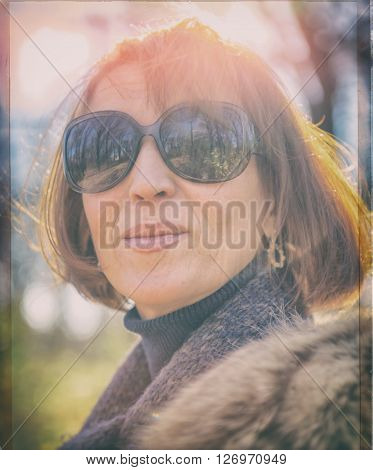 portrait of a pretty woman in sunglasses age 40 years