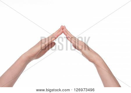 Two old woman's hands clasped all together as if it is roof. Such sign or gesture is used for protection.