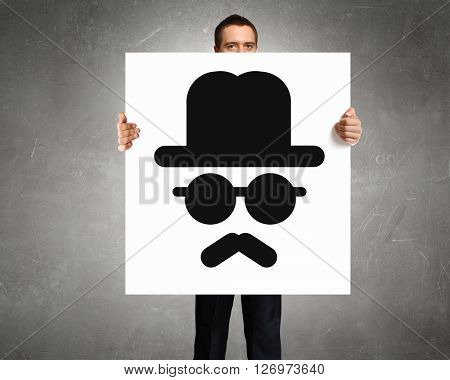Man show banner with upset smiley
