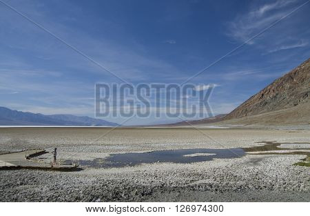 Bad Water Basin in Death Valley (California) - standing man