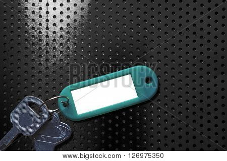 Keys with blank key fob on aluminum texture background