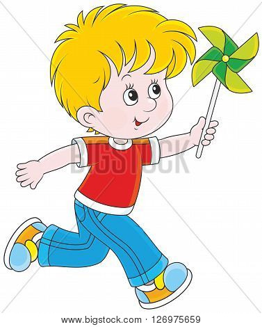 little boy running and playing with a toy whirligig