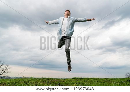 Young man flying in sky background outdoors