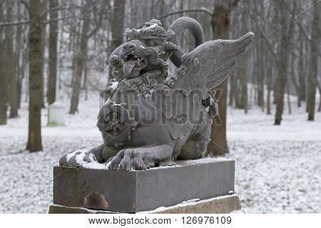 The sculpture of the dragon on the bridge closeup gloomy winter day. Tsarskoye Selo, Russia