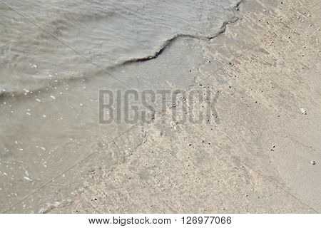 Water And Mud Texture Or Wet Brown Soil In The River.