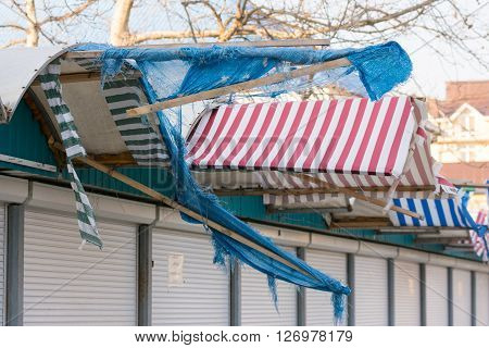 Torn Fabric Awnings Over The Closed Seaside Shops In The Offseason