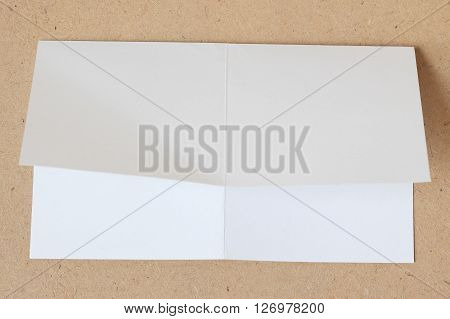 crumpled unfolded piece of white paper on wood background