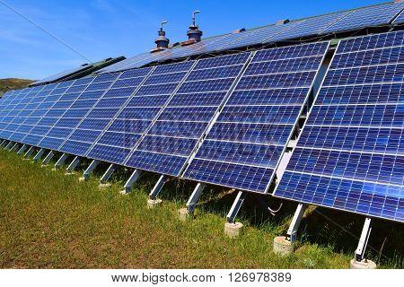 Modern solar panels taken on a property producing clean alternative energy
