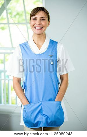 Portrait of happy nurse standing at health club