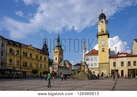 Banska Bystrica, Slovakia - May 10, 2013: Town square with Clock Tower and medieval castle in Banska Bystrica.