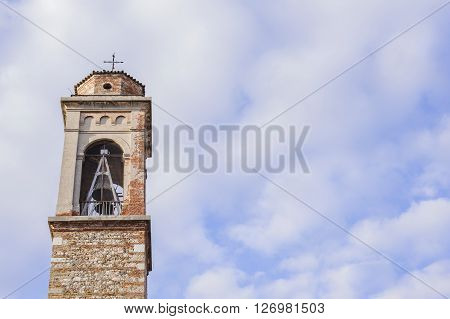 bell tower with a bell of a country church