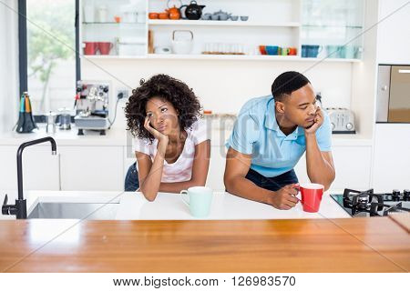 Young couple upset with each other while having coffee