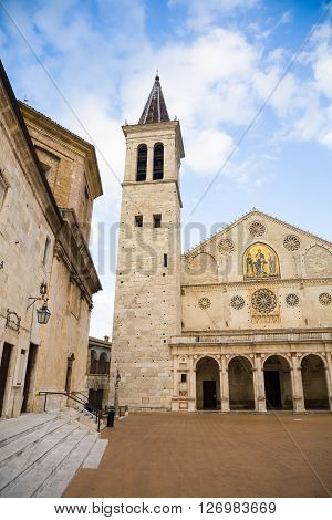 The cathedral of the town of Spoleto at dusk in Umbria in Italy