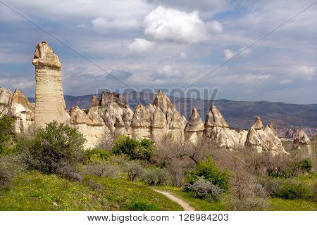Tuff rock against the blue sky in the Valley of Love. Cappadocia.