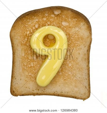 Isolated Toast with butter number 9 isolated on a white background
