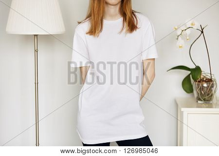 Cropped Portrait Of Cute Redhead Teenage Girl In Blank White T-shirt For Your Text Message Or Advert