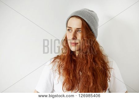 Close Up Studio Portrait Of Attractive Young Female Looking Away With Dreamy And Mysterious Smile. H