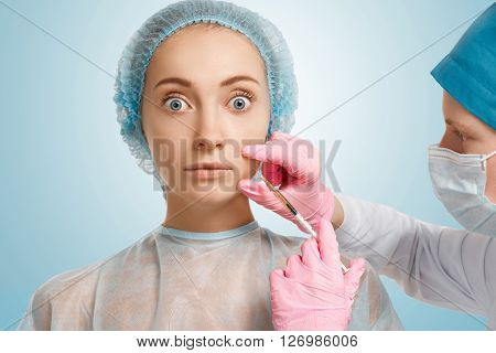 Close Up Of Shocked Caucasian Woman Getting Anti-aging Injections With Scared Expression In Beauty C
