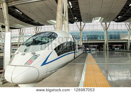 BEIJING CHINA - APRIL 22 2013 : High speed train at HSR station on April 22 2013 in Beijing China