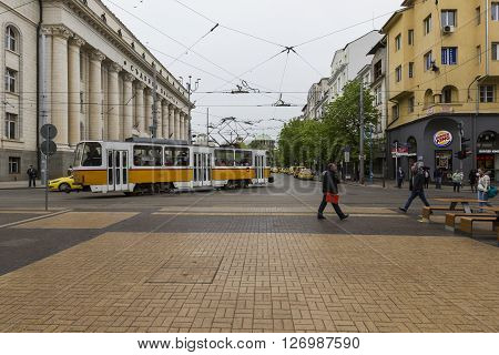 SOFIA BULGARIA - APRIL 14 2016 : Tranway and street scene of downtown city of Sofia the capital of Bulgaria. In Sofia.