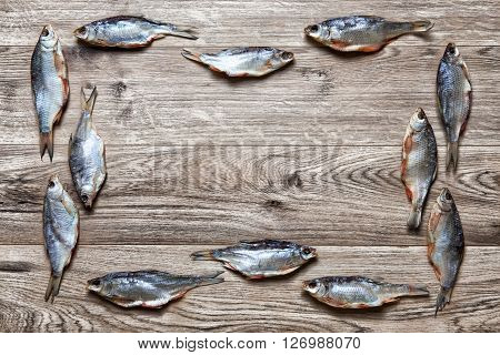 Dry fish on a wooden background  large amount