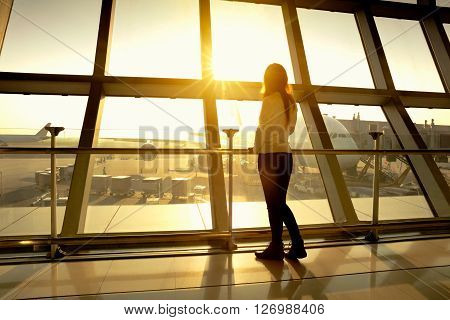 Woman at airport with morning sunlight, Travel concept