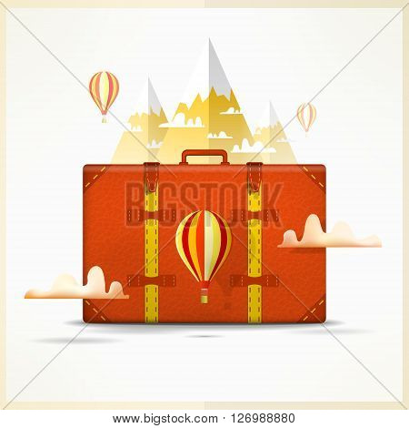 Travel to mountains background. Travelling and hiking concept. Travellers scene with suitcase, balloon, snow peaks and clouds.