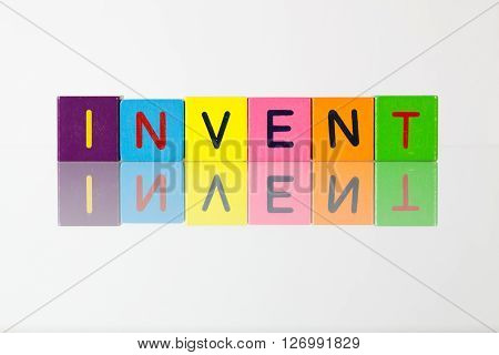 Invent - an inscription from children's wooden blocks
