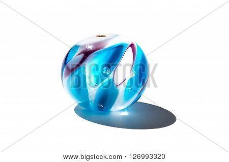 Hand made transparent blue glass bead on white background