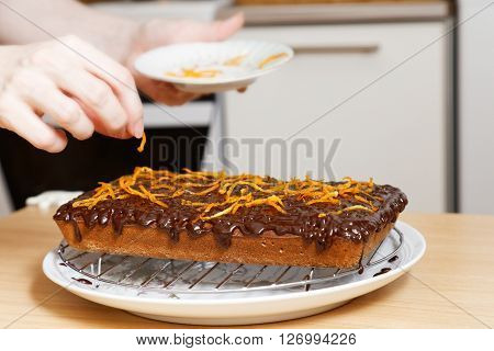 Chef Decorate The Cake With Honey And Orange Peel