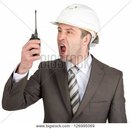 Businessman in suit and helmet screaming at walkie-talkie. Isolated on white background