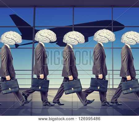Goup of businessmen with brains instead heads in airport