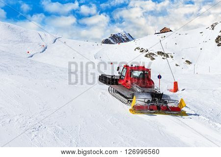 Photo of red ratrak in action on the ski slope