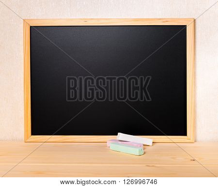 Empty Blank School New Black Board With Colored Chalks On Table, Close Up