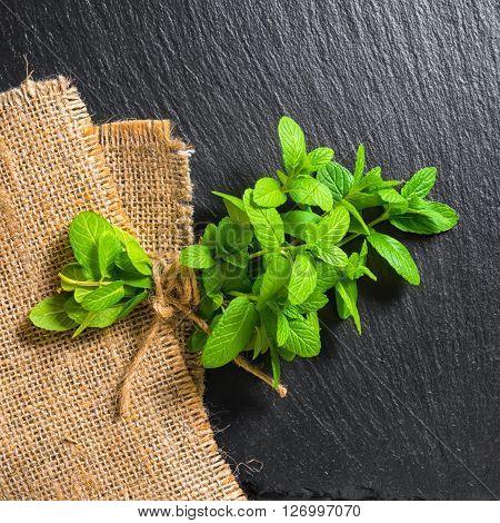 Beautiful Bunch Fresh Green Lemon Mint Tied Twine On Slate And Burlape Background, Close Up