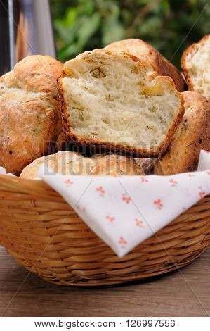 Homemade buns with cottage and dill in a basket